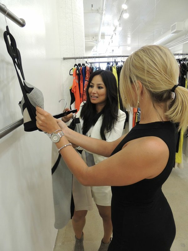 MARKET MEETINGS: Vishaka Lama of the New Mart's ShowroomFive21 shows Australian dress line Lumier by Bariano to Colby Walksler during the recent Los Angeles Fashion Market.