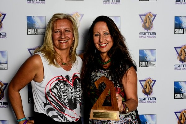 """Twin sisters Coco and Izzy Tihanyi have been running a surf school for almost two decades and their Surf Diva boutique won for """"Women's Retailer of the Year."""" (Photo by Brent Hilleman)"""