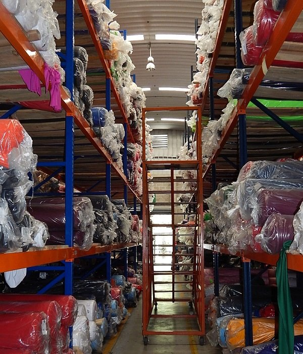 To keep up with demand for quick-turn orders, Custom Made Services, a full-package company in Guatemala, is based in a more technical warehouse that helps the company pick fabric faster. The company also bought an ERP (enterprise resource planning) sys­tem to help replenish orders quickly.