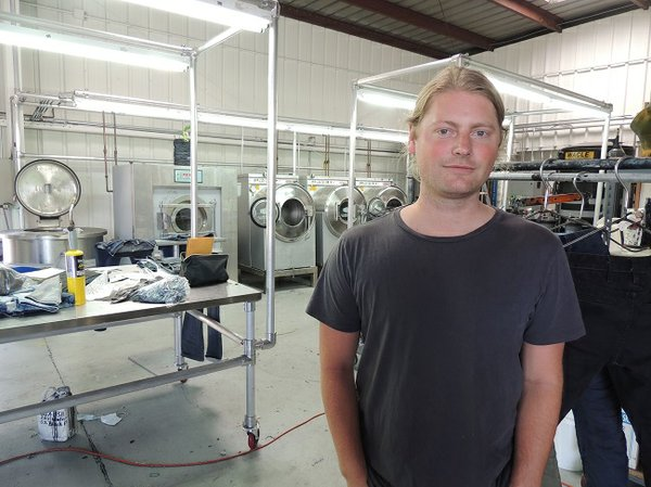 WASH ALTERNATIVE: Lukus Eichmann, founder of Tortoise, at Eco Prk laundry. Eichmann said the laundry offers a different way to give jeans a stylish look, one that doesn't use chemicals deemed harmful.