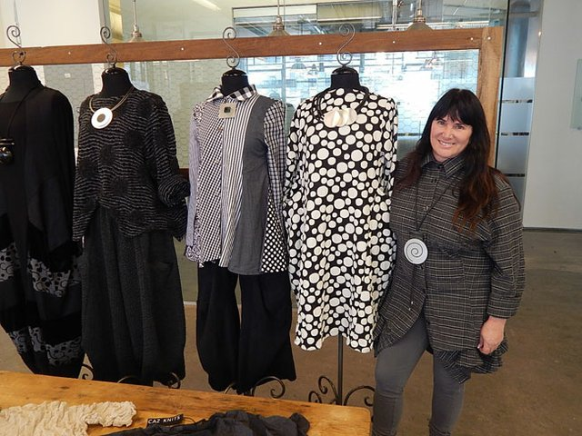 ARTSY CREATIONS: Jane Mohr stands next to her Dress to Kill styles. On the far left is a dress created by Avivit Yizhar.