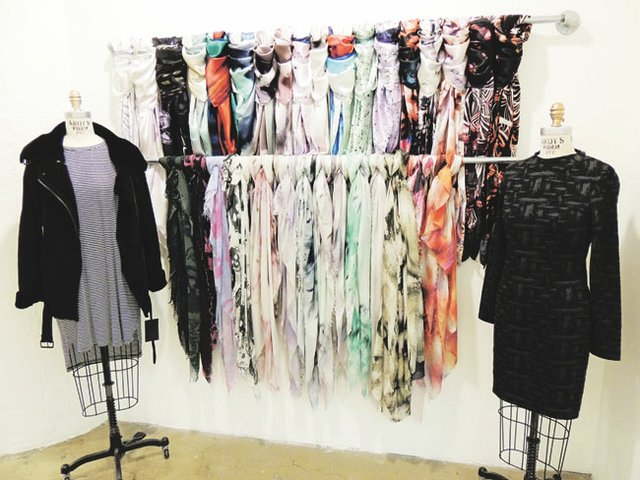 A display of Shai Shanti scarves with pieces from the Just Female collection.