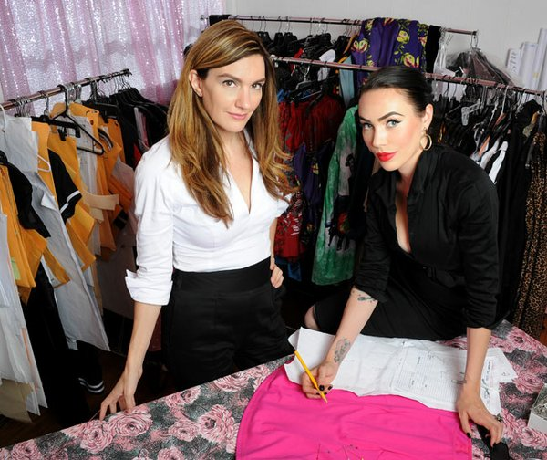 CREATIVE DIRECTION: Laura Byrnes, on the left, started Pinup Girl Clothing out of her living room. Now there are 13 people in the company, including Micheline Pitt, right, vice president of design and special projects.