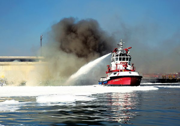WATER POWER: A Los Angeles Fire Department boat tries to put out a fire that started Monday evening at Berth 177 at the Port of Los Angeles.