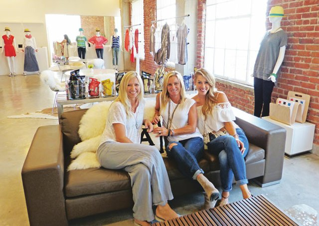 Beth Hutton, Kari Carpino and Missy Cook in the Allen Allen showroom at The New Mart