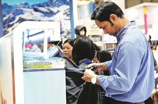 BIG SHOW: The Oct. 20–23 run of Intertextile Shanghai Apparel Fabric 2014 trade show will feature more than 3,800 exhibitors showing in 15 halls spread across a more than 10 million-square-foot exhibition space at the Shanghai New International Expo Centre.