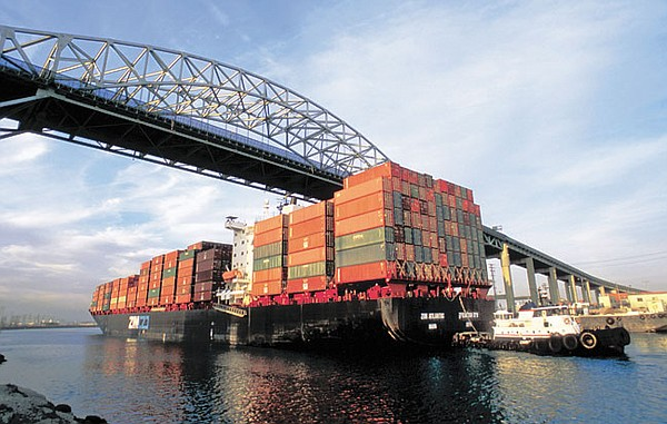 CLEAR CRUISING: A cargo-container ship piled with imports sails into the Port of Long Beach.