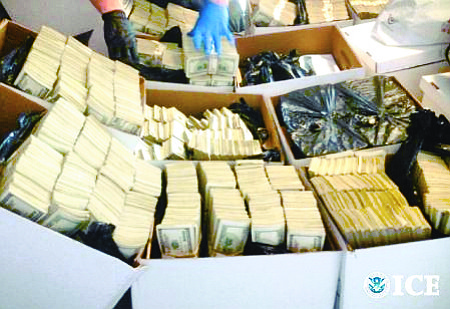CASH CACHE: Federal investigators raided several fashion businesses and residences allegedly involved in laundering drug money for Mexican cartels. In one condo, they found $35 million in cash stored in cardboard boxes.