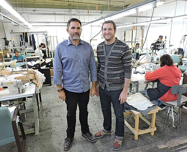 Brian Weitman and Jack Ribakoff in the sewing room at Security Sourcing International Apparel.