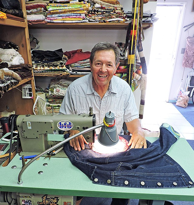 A MAN & HIS SEWING MACHINE: Fernando, the namesake of the Fernando's boutique in Redondo Beach's Riviera Village, behind his Juki sewing machine.