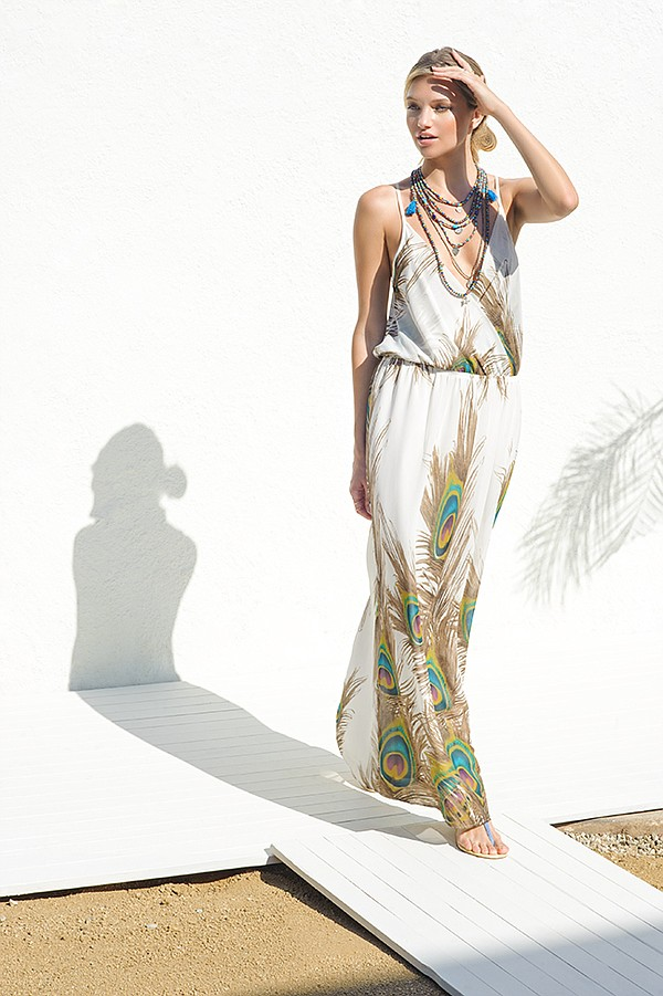 "SINGLE's ""Peacock"" maxi dress. BINDY's multi-beaded string necklace with turquoise tassels."