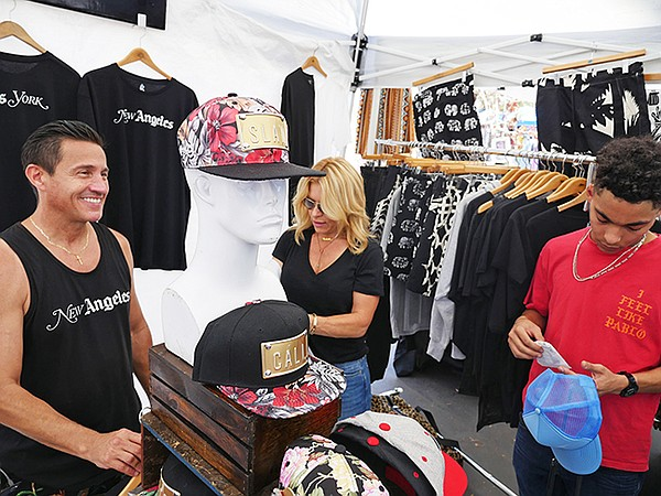 Freddie Rojas, pictured left, at his stand at Melrose Trading Post