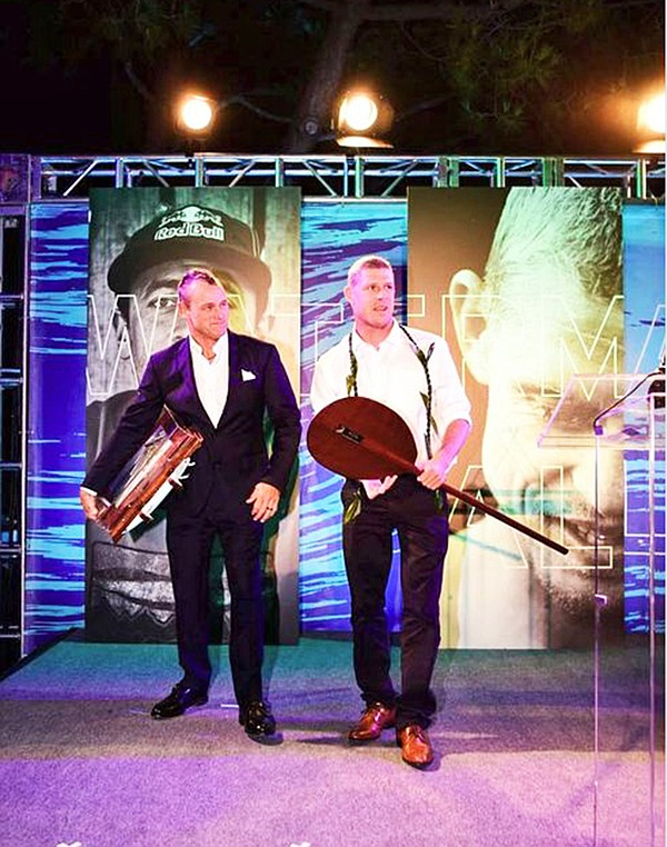TROPHIES: Mick Fanning, right, receives his Waterman of the Year trophies.