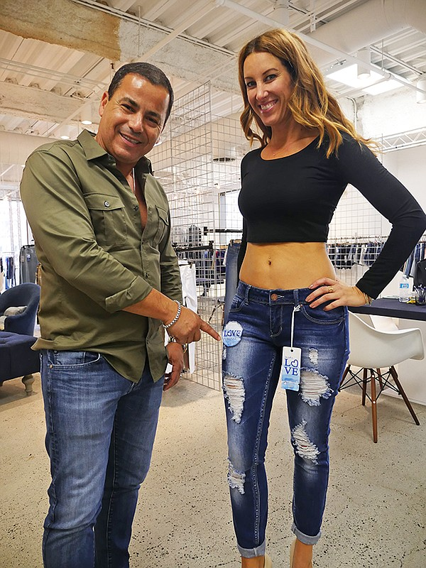 David Vered, YMI Jeans president, left. Kelly Wilson models jeans.