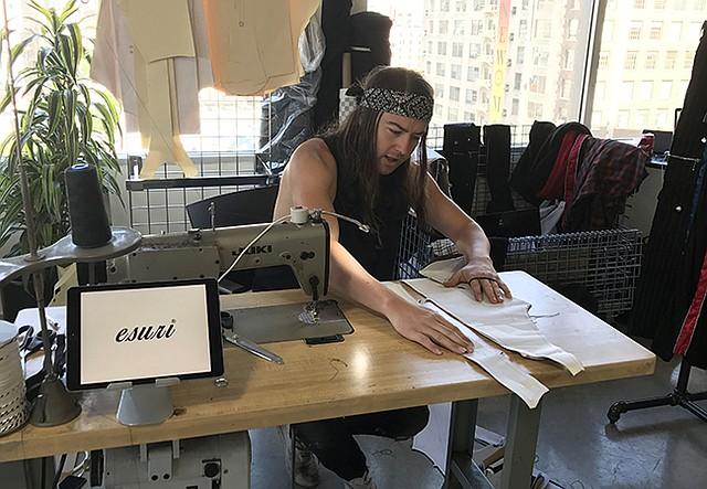 Designer Elliott Evan, making one-of-a-kind garments at Esuri brand booth