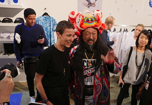 Sarah Andelman poses with Takashi Murakami at the Colette Paris booth.