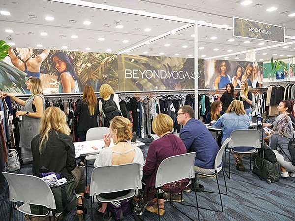 ACTIVE COLLECTIVE: A steady flow of buyers shopped the Active Collective trade show Jan. 11–12 in Anaheim, Calif. Above, meetings at the Beyond Yoga brand's booth.
