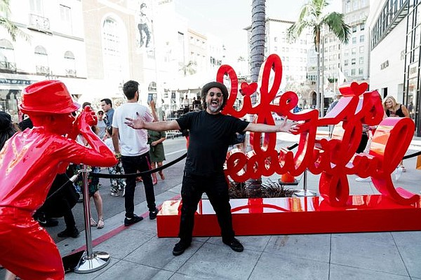 Mr. Brainwash unveils statue on Rodeo Drive on Aug. 1. Photo by Lex and Tim for @scottclarkphoto
