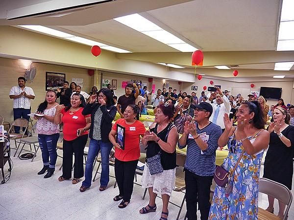 Garment workers celebrating.
