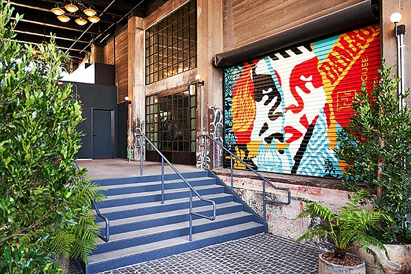 Shepard Fairey art by the entry to Soho Warehouse