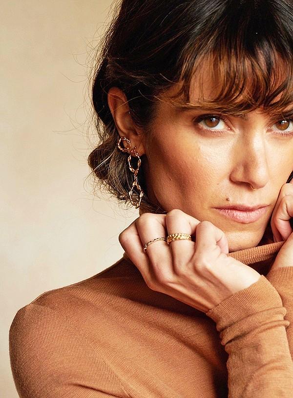 Nikki Reed models the BaYou with Love Diamond Petal Drop earrings.