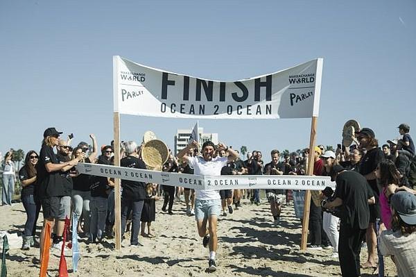 Sam Bencheghib at finish line of Ocean2Ocean run. Photo by Jacqueline Verdugo