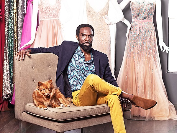 Kevan Hall with his dog Gypsy at his atelier on Beverly Boulevard | Photo courtesy of Kevan Hall