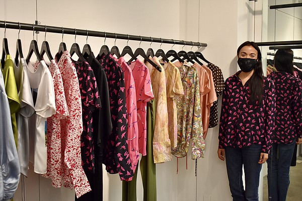 Catherine Gee stands beside her Spring 2021 collection during L.A. Market at the Cooper Design Space.   Photo courtesy of Catherine Gee