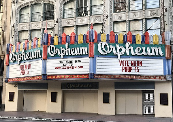 An anti–Prop. 15 message on DTLA's shuttered Orpheum Theatre regarding the hotly debated commercial-property-tax bill.
