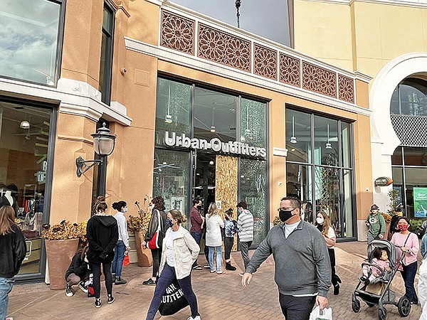 Shoppers at the Irvine Spectrum Center on Dec. 12 and The Grove (below) on Dec. 19 contribute to a successful holiday-sales season as they shop despite economic challenges during 2020.