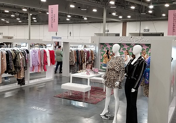 During their visits to MAGIC, buyers were interested in finding unique pieces, but also the tactile experience of examining clothing with exhibitors, such as Buddy Love, which sold out of its hot-pink faux-fur coat.