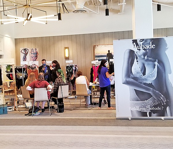 During Curve Los Angeles, buyers met with representatives from Easton International and the Wells Apparel Group, whose Ginny Wells reported trends in ecologically sound intimates and Holiday goods.   Photo courtesy of CURVE Los angeles