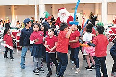 Neighborhood Kids Meet Santa and Receive Gifts at the Annual Holiday Party by CFF and TALA