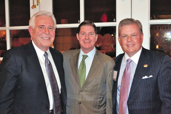 EXECUTIVE CHANGE: New AAFA Chairman Philip Williamson, chairman, president and CEO of Williamson-Dickie Co., flanked by Rick Darling, president of LF USA, left, and AAFA President and Chief Executive Officer Kevin Burke, right.