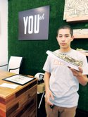James Rosas of Fairfax store YOUth, holding a custom Vans shoe featuring work from artist @Blue the Great