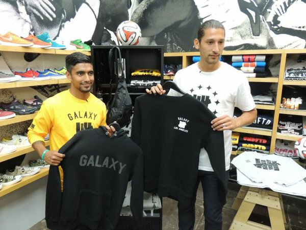 Galaxy Defenders A.J. DeLaGarza, left, and Omar Gonzalez show off looks from the LA Galaxy X UNDFTD capsule collection at the Undefeated shop in Santa Monica.