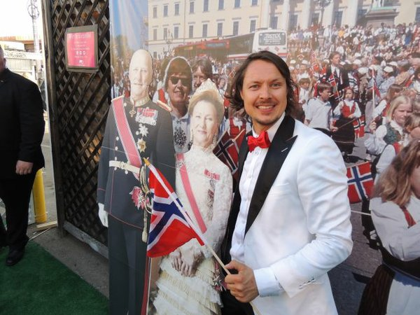 Stefan Dahlkvist with cardboard cut outs of Norway's King Harald and Queen Sonja on May 17 party at the Moods of Norway store.