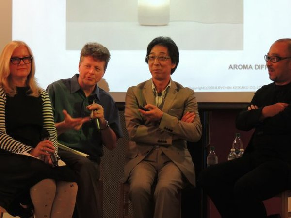 From left, Brooke Hodge, of Hammer Museum, a translator, Masaaki Kanai of Muji and Hitoshi Abe, chair of UCLA's department of architecture and urban design.