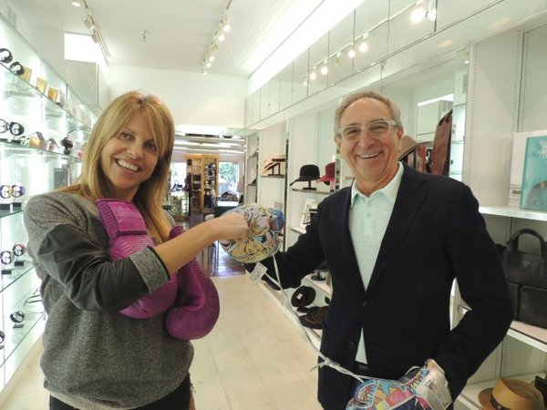 Duking it out, wearing Elizabeth Weinstock boxing gloves, are Karen Meena, vice president of buying and merchandising of Ron Robinson, and Ron Robinson.