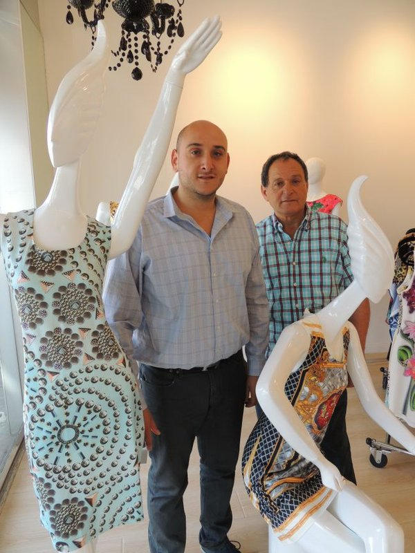Baciano by Bacci's Eli Pirian, center, and Jacob Pirian, right, at the new showroom/headquarters/boutique for Baciano by Bacci.