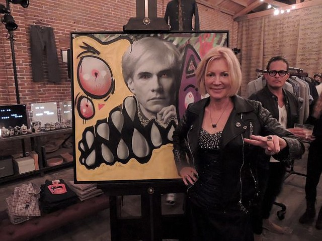 Karen + Bystedt in front of a Lost Warhol lithograph at Guerilla Atelier on Dec. 10.