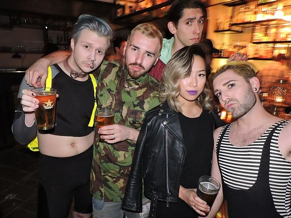 Seen at Underbelly's debut: Sean East, at left with blue hair, Sinh Vo, second to right and Gregory Darling at right, with an unnamed friend and a photobomber.