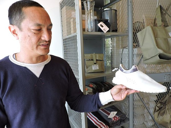 Richard Cofinco holding ASIF footwear.