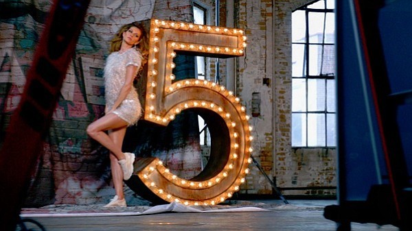 "You can watch Baz Luhrmann's Chanel No. 5 film featuring Gisele Bündchen and Michiel Huisman, as well as Lo-Fang trippy version of ""The One That I Want"" at www.chanel.com"
