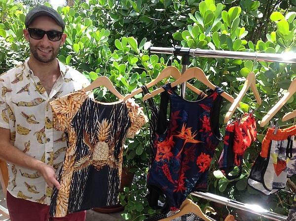 Jeremy Somers of We Are Handsome shows off the brand's latest at a brunch for editors at Miami Swim Week