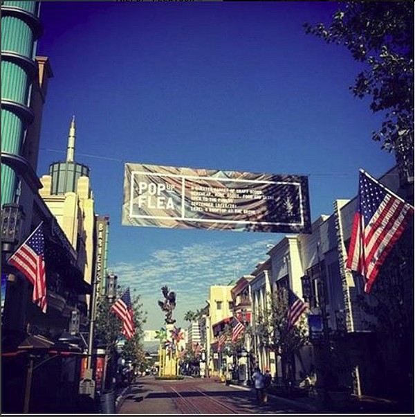 Banner at The Grove advertising Pop Up Flea. Image via Pop Up Flea's Instagram pop-up-flea.