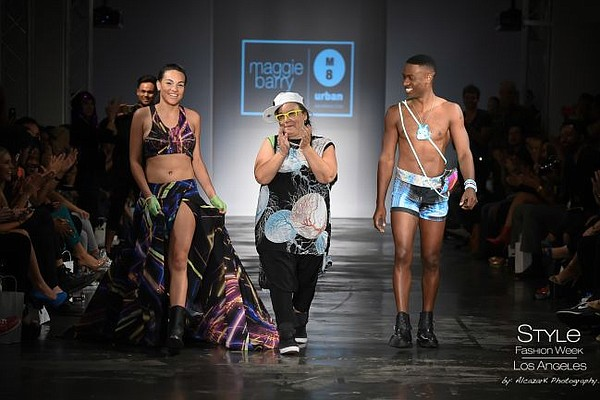 Maggie Barry, center, takes a bow for the runway show at M8 Urban. All photos courtesy of Maggie Barry.