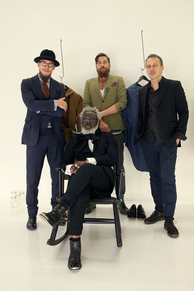 HERE COMES NORWEGIAN RAIN: T-Michael, a designer of Norwegian Rain and his self named line, T-Michael, seated. Standing from left, Alexander Helle, Norwegian Rain creative director, Wesley Swolfs also of Norwegian Rain and Eric Beugnet of Modern Tribute. Photo by Landra Dulin/LAFW