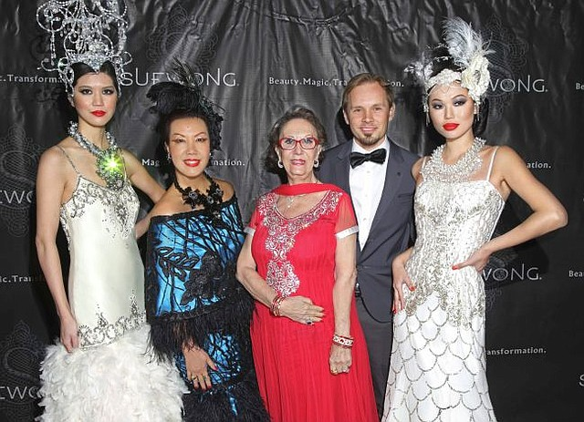 Sue Wong in blue gown, with models and an unnamed male guest. In red gown Alexandrina Doheny. Picture by Sheri Determan
