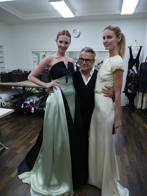 Mark Zunino and two models wearing his gowns. Picture taken in his new atelier's workroom.
